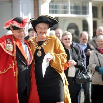Percy is greeted by the mayor